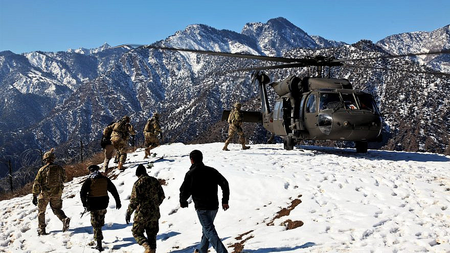 U.S. and Afghan National Army soldiers board a U.S. Army UH-60 Black Hawk helicopter at Observation Post Mangol in the Nari district, Kunar province in Afghanistan, on Feb. 8, 2012. Credit: Sgt. Trey Harvey, Joint Combat Camera Afghanistan, U.S. Department of Defense via Wikimedia Commons.