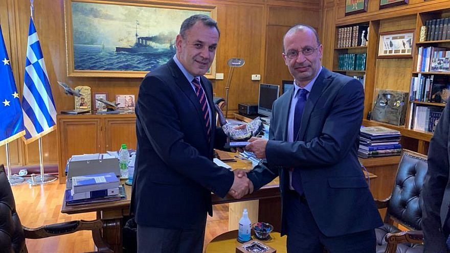 Yoram Shmuely, executive vice president and general manager of Elbit's Aerospace Division, right, shakes hands with Greek Defense Minister Nikolaos Panagiotopoulos in Athens on April 16, 2021. Credit: Elbit Systems