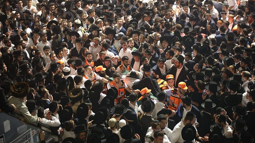 United Hatzalah emergency-service workers attempt to evacuate the injured in Meron in northern Israel after Jewish worshippers were crushed during Lag B'Omer festivities, April 30, 2021. Credit: United Hatzalah.