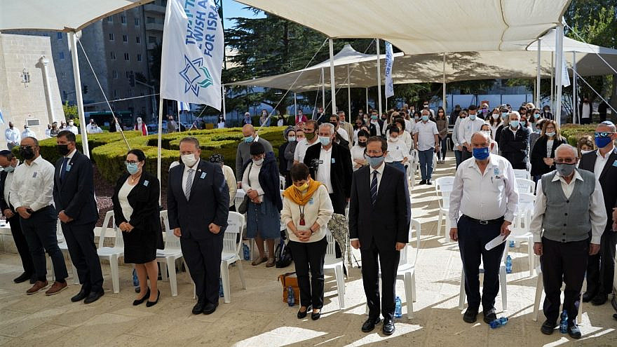 "Participants at the Jewish Agency for Israel's annual Yom Hazikaron ceremony, which also honored the sinking of the ""Egoz"" ship in 1961, as well as terror victims and those injured or killed in anti-Semitic attacks worldwide, April 13, 2021. Credit: The Jewish Agency for Israel."
