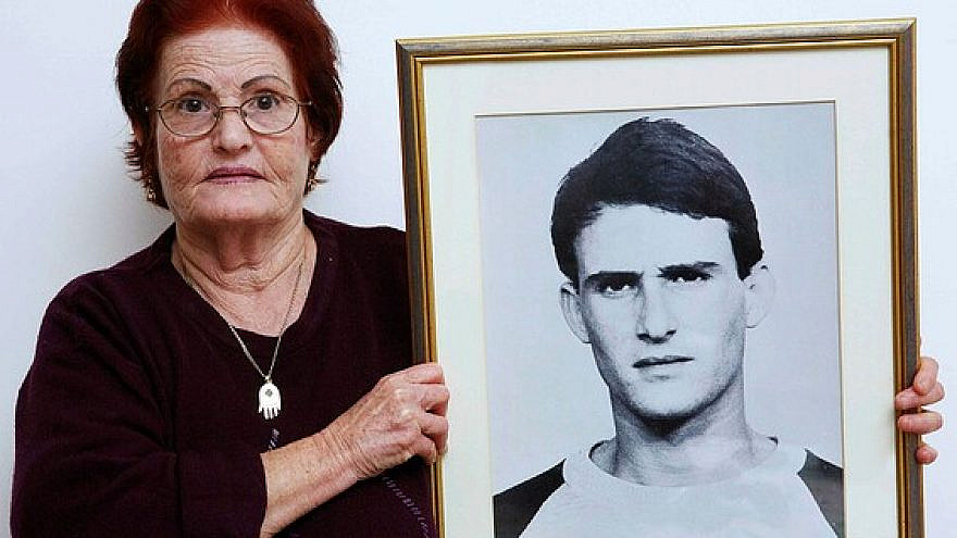Galia Tamam holds a picture of her son, Moshe, who was murdered by Palestinian terrorists in 1984. Photo by Yehoshua Yosef.