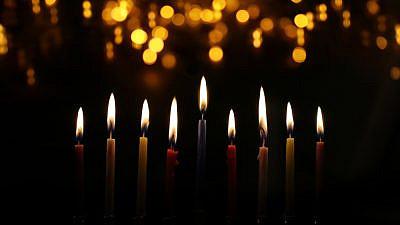 Candles from a Hanukkah menorah. Credit: tomertu/Shutterstock.