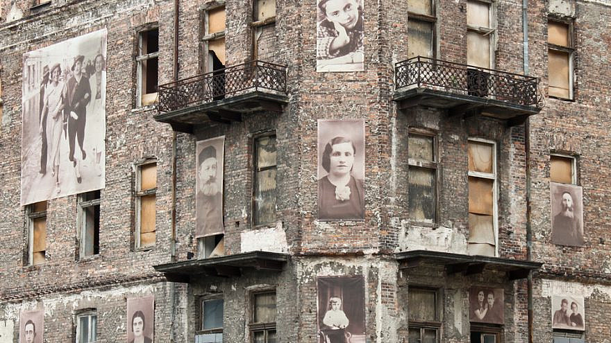 A building from the Warsaw Ghetto with pictures of Jews on the facade. Credit: Anastasia Petrova/Shutterstock.