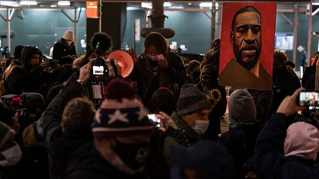 Protesters rally and march in Bryant Park, N.Y., on the first day of the trial of Minneapolis police officer Derek Chauvin, accused of killing African-American George Floyd on May 25, 2020. Credit: Lev Radin/Shutterstock.