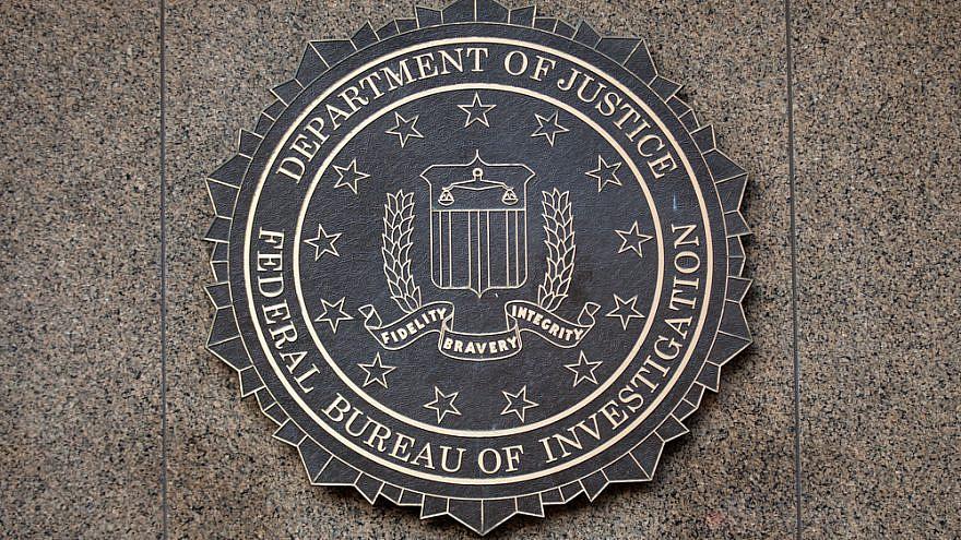 The FBI seal located outside the J. Edgar Hoover FBI Building in downtown Washington, D.C., on Dec. 26, 2014. Credit: Mark Van Scyoc/Shutterstock.