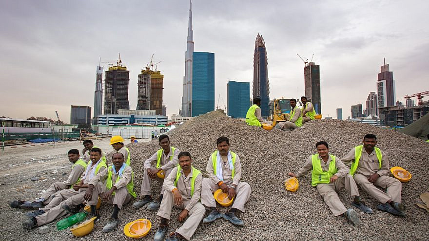 Panorama of Dubai Financial Center and construction site with workers on a break. Credit: Rasto SK/Shutterstock.