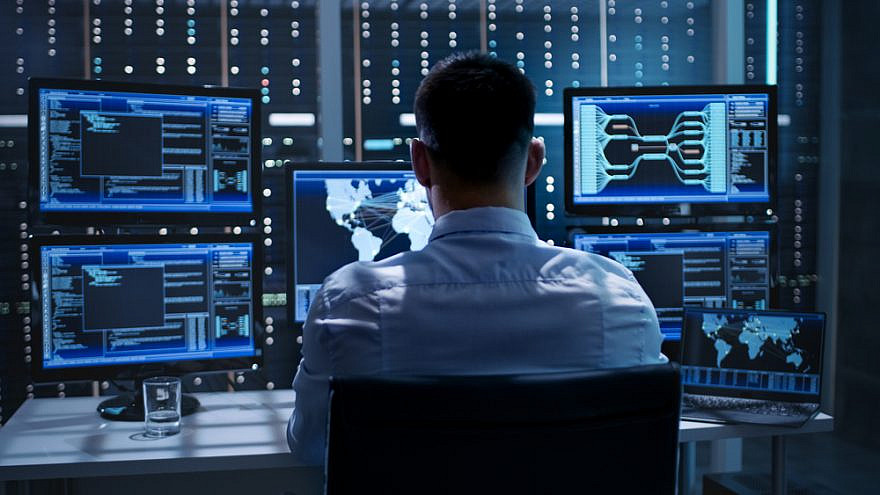 A system security specialist working at System Control Center.  Credit: Gorodenkoff/Shutterstock.