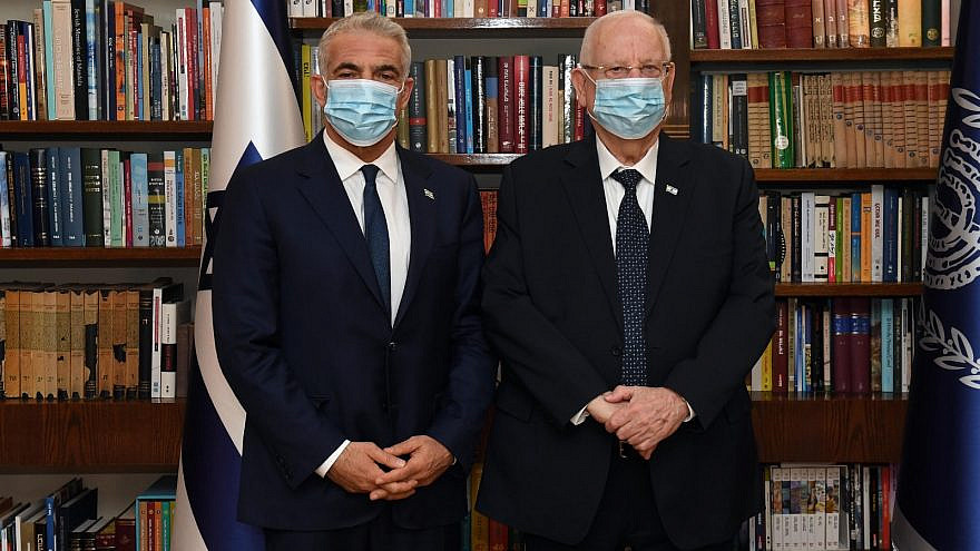 Yesh Atid Party leader Yair Lapid (left) with Israel's President Reuven Rivlin after receiving a mandate to form the next government, May 5, 2021. Source: Yair Lapid/Facebook.