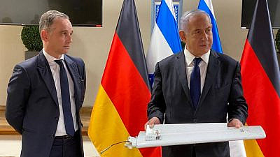 Israeli Prime Minister Benjamin Netanyahu presenting part of a drone shot down during a meeting with Germany's foreign minister in Tel Aviv on May 20, 2021. Credit: Kobi Gideon/GPO.