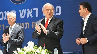 Incoming Mossad head David Barnea (left), Israeli Prime Minister Benjamin Netanyahu and outgoing Mossad chief Yossi Cohen. Credit: GPO.