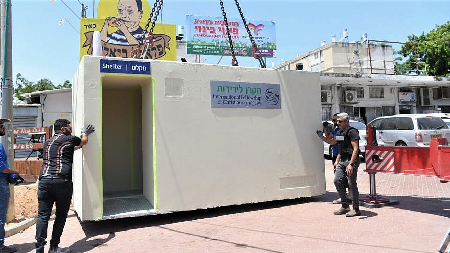 Workers with the KAIROS Company for the International Fellowship of Christians and Jews set in place a mobile bomb shelter, May 13, 2021. Credit: IFCJ.
