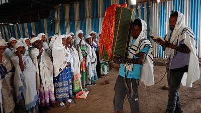 Members of Ethiopia's Jewish community carrying Torah Scrolls into synagogue. Credit: Struggle to Save Ethiopian Jewry.