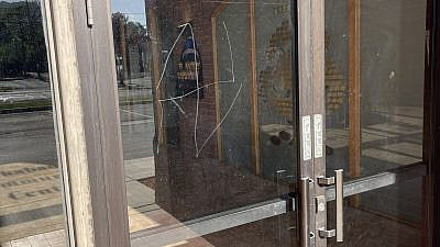 A swastika was scratched onto the front-door glass of Chabad Lubavitch of Utah in Salt Lake City, May 2021. Source: Twitter.
