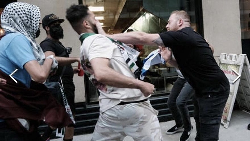 Snir Dayan and Amit Skornik defending themselves after being attacked by pro-Palestinian protesters in New York City, May 2021. Source: Screenshot.