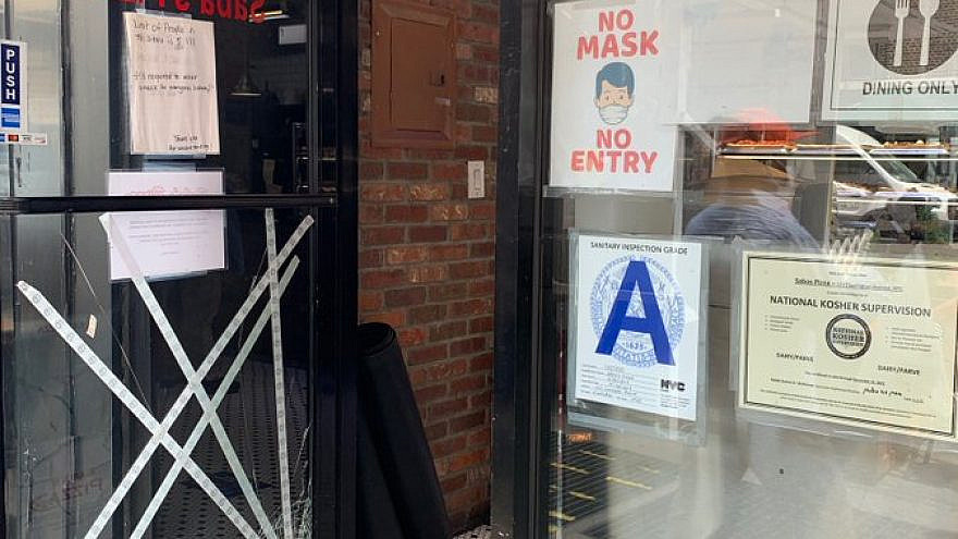 A view of the damaged glass door at Saba's Pizza on New York City's Upper East Side, May 24, 2021. Source: Twitter.