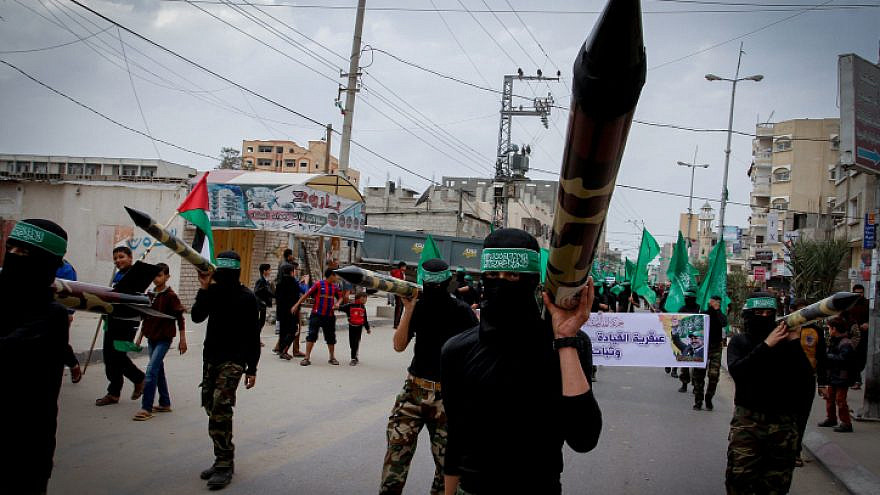Masked members from the Ezzedine al-Qassam carry a model of a rocket during a rally to commemorate the 27th anniversary of the Islamist movement creation Hamas, at the Nuseirat refugee camp in the Central Gaza Strip on December 12, 2014. Photo by Abed Rahim Khatib / Flash90