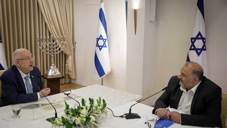 Mansour Abbas, head of the Ra'am Party, meets with Israeli President Reuven Rivlin at the President's Residence in Jerusalem on April 5, 2021. Photo by Yonatan Sindel/Flash90.
