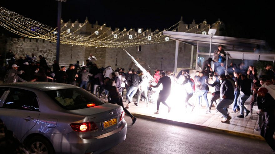 Israeli police clash with rioters outside Damascus Gate in Jerusalem on April 22, 2021. Photo by Jamal Awad/Flash90.
