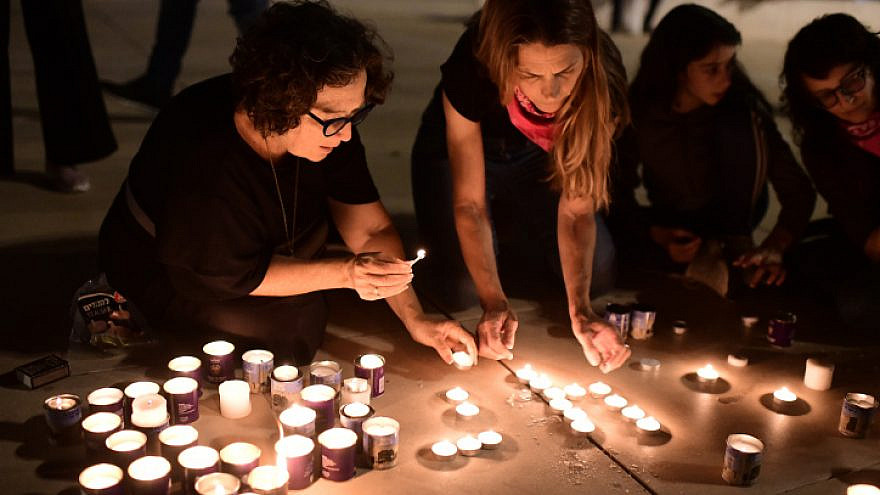 Israelis light candles at Habima Square in Tel Aviv for the 45 people killed in a crushing crowd at Mount Meron during Lag B'Omer celebrations, May 1, 2021. Photo by Tomer Neuberg/Flash90.