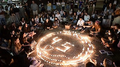 Israelis light candles in Tel Aviv's Rabin Square for the 45 victims killed in a crushing crowd at Mount Meron during Lag B'Omer celebrations, May 2, 2021. Photo by Tomer Neuberg/Flash90.