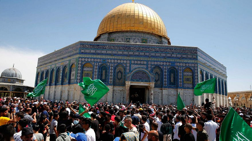 People wave Hamas flags outside the Dome of the Rock in Jerusalem, May 7, 2021. Photo by Jamal Awad/Flash90.