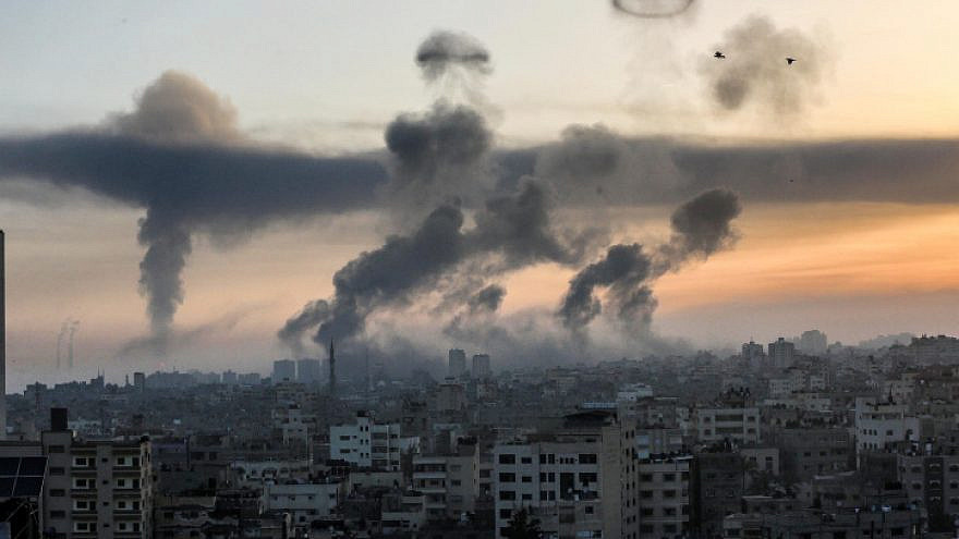 Smoke rise following an Israeli airstrike in Gaza City, on May 12, 2021. Photo by Atia Mohammed/Flash90.