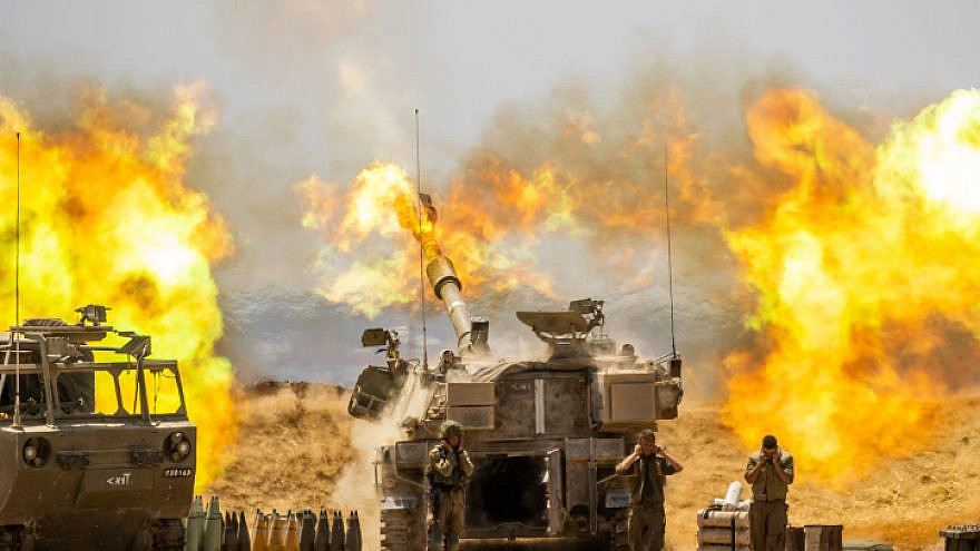 IDF Artillery Corps fire into the Gaza Strip, near the border with Israel, following heavy rocket and missile barrages into Israel by Hamas and other terror factions, May 12, 2021. Photo by Yonatan Sindel/Flash90.