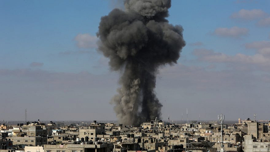 Smoke billows after an Israeli airstrike on the city of Rafah, in the southern Gaza Strip, on May 13, 2021. Photo by Atia Mohammed/Flash90.