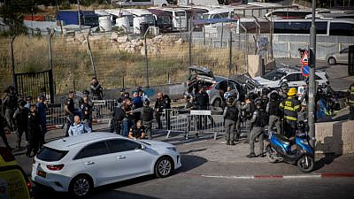 Police at the scene of a vehicular assault in Jerusalem's Sheikh Jarrah neighborhood. Several police officers were wounded in the incident, two of them moderately, May 16, 2021. Photo by Yonatan Sindel/Flash90.