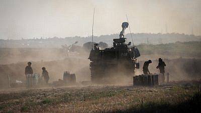 The Israel Defense Forces Artillery Corps fires into the Gaza Strip near the Israeli border on May 19, 2021. Photo by Olivier Fitoussi/Flash90.