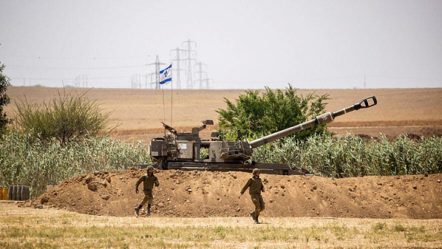 IDF Artillery Corps seen firing into Gaza, near the Israeli border with Gaza on May 20, 2021. Photo by Yonatan Sindel/Flash90