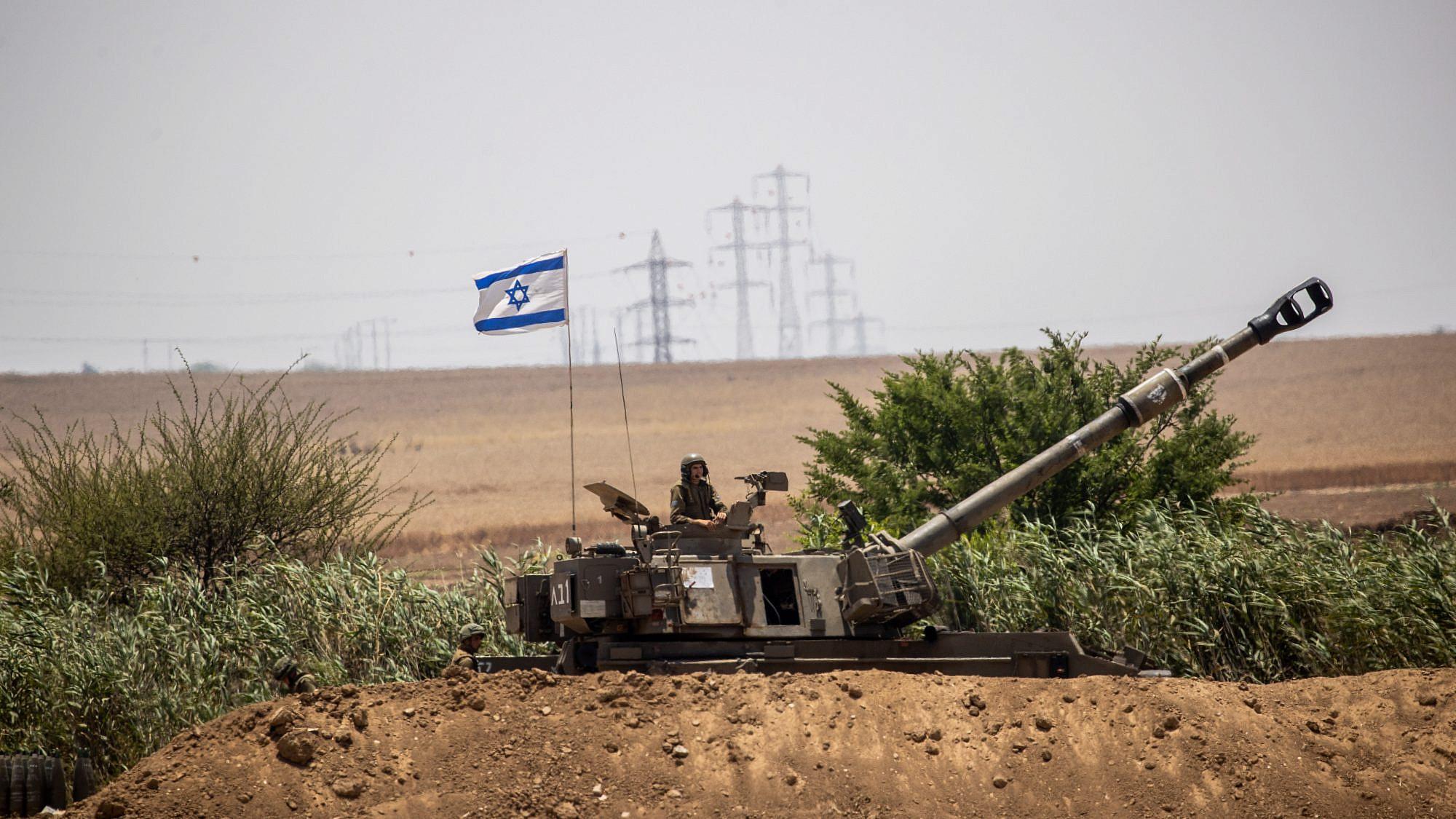 IDF (Israel Defense Force) Artillery Corps seen firing into Gaza, near the Israeli border with Gaza on May 20, 2021. Photo by Yonatan Sindel/Flash90
