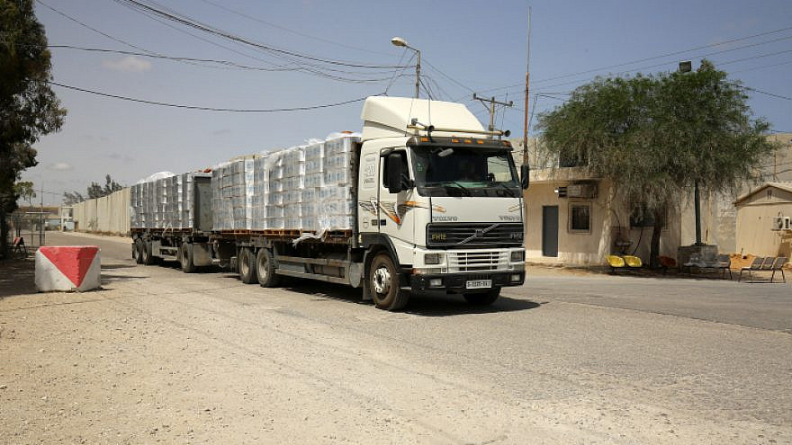 A truck loaded with humanitarian aid passes through the Kerem Shalom border crossing, the main passage point for goods entering the Gaza Strip from Israel, May 21, 2021. Photo by Abed Rahim Khatib/Flash90.