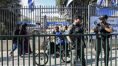 Israeli police officers secure a Jewish school following recent clashes between Jewish and Arab residents of Lod, in central Israel, on May 23, 2021. Photo by Flash90.