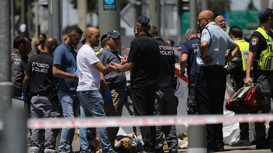 Israeli Police at the scene of a stabbing attack near Ammunition Hill in Jerusalem, where two young men were injured and the assailant was neutralized by officers on the scene, May 24, 2021. Photo by Yonatan Sindel/Flash90.