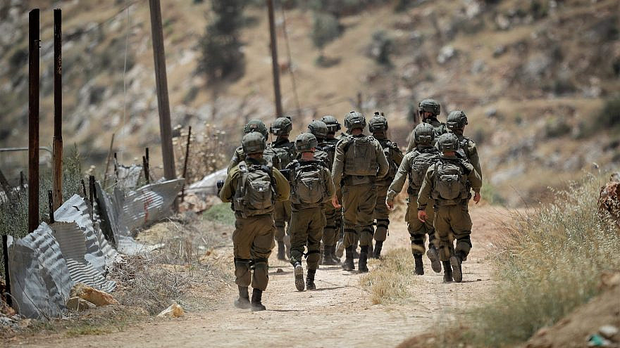Israeli soldiers surround a farmhouse in the village of Aqraba, east of Nablus in the West Bank, during an Israeli security operation to search for Palestinian militants, May 5, 2021. Photo by Nasser Ishtayeh/Flash90.