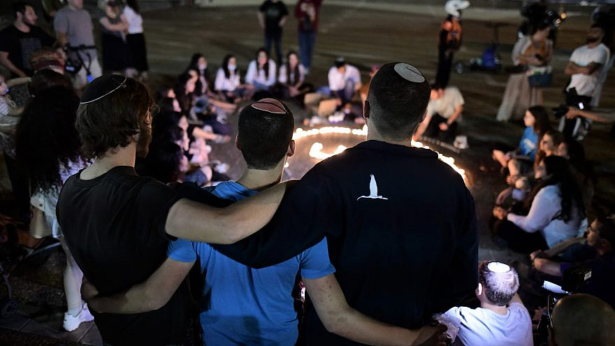 Israelis comfort one another in Tel Aviv's Rabin Square following the Lag B'Omer stampede in Meron that resulted in the deaths of 45 Jewish worshippers, May 2, 2021. Photo by Tomer Neuberg/Flash90.