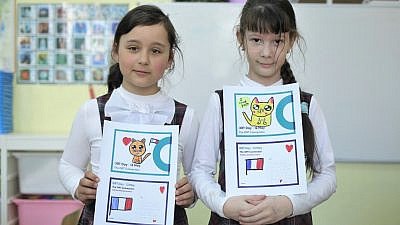 Kids in St. Petersburg, Russia, display their work as part of an ORT day postcard exchange. Credit: Courtesy.