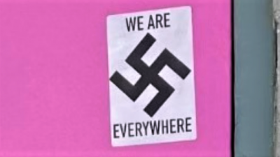 """Swastika stickers found on the Alaska Jewish Museum and """"Mad Myrna's"""" bar on May 26, 2021. Credit: Anchorage Police Department."""