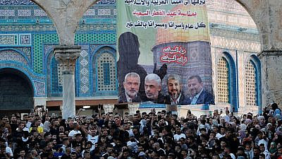 A pro-Hamas poster featuring the heads the terror organization, in front of the Dome of the Rock in Jerusalem, on May 13, 2021. Credit: Israel Hayom.