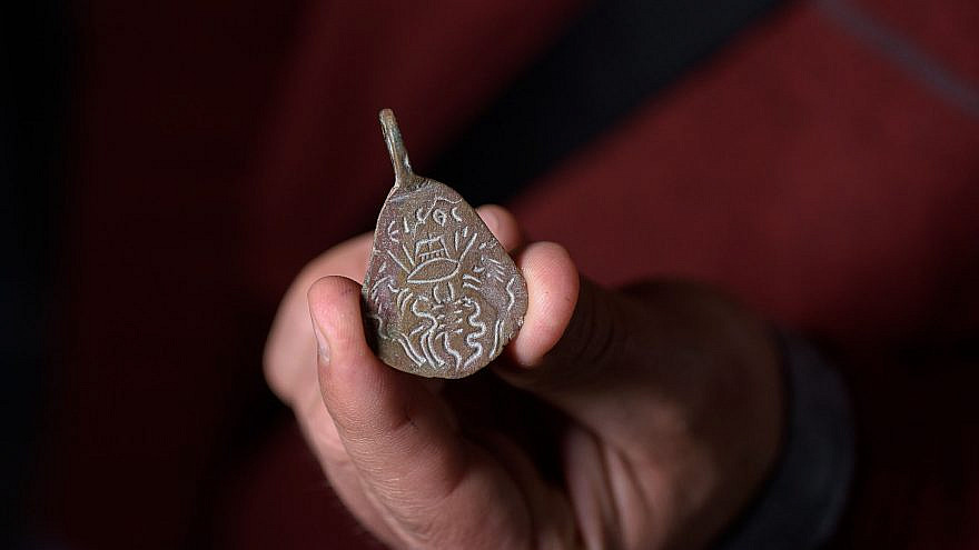 An ancient amulet that was found 40 years ago in the Galilee and recently handed over to the National Treasures Center. Credit: Dafna Gazit/Israel Antiquities Authority.