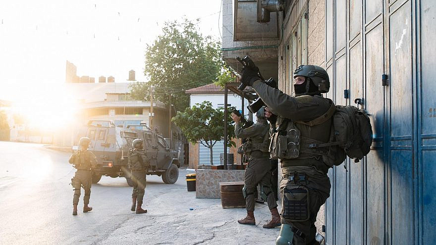 Israel Defense Forces search a West Bank village as part of a manhunt for the perpetrators of a drive-by shooting at Tapuach Junction near Ariel, May 4, 2021. Credit: IDF.