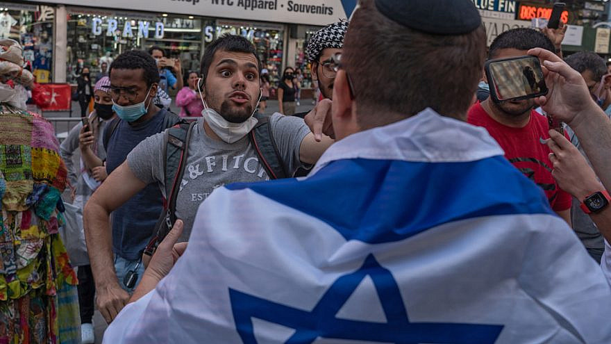 Pro-Palestinian protesters face off with police in a violent clash in Times Square during a pro-Israeli rally resulting in dozens of arrests, May 2021. Credit: Ron Adar/Shutterstock.