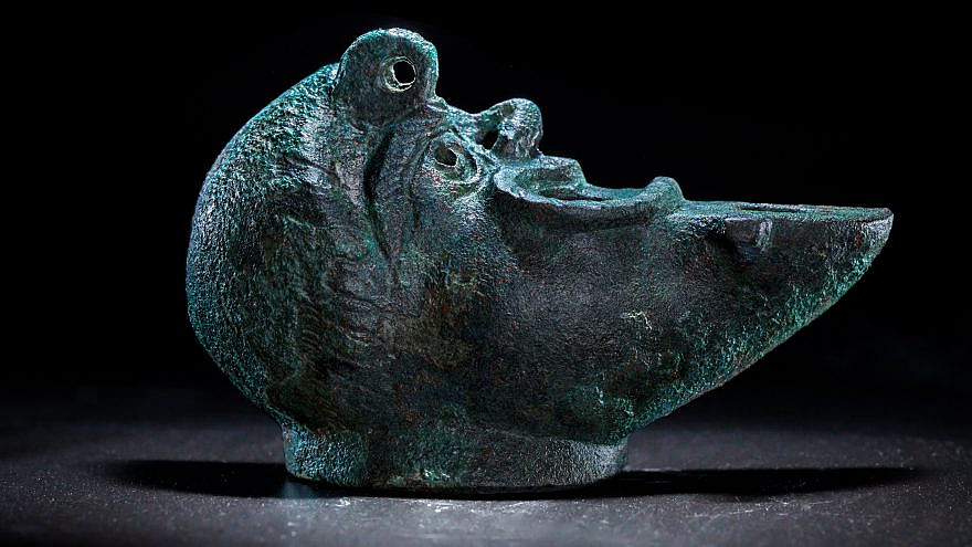A rare bronze oil lamp, shaped like a grotesque face cut in half, was recently discovered during excavations in Jerusalem's City of David National Park. May 5, 2021. Credit: Israel Antiquities Authority.