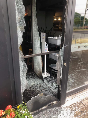 The shattered glass door of the kosher restaurant Chez Benny in Montreal, June 13, 2021. Credit: Courtesy of B'nai Brith Canada.