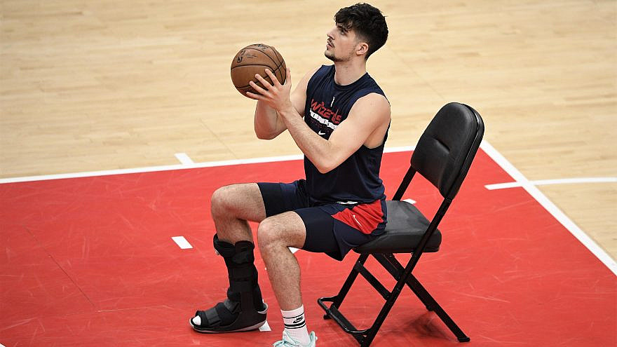 Washington Wizards player Deni Avdija recovering from an injury at the end of a basketball season that saw the team make the playoffs, losing to the Philadelphia 76ers on June 2, 2021. Credit: AP Photo/Nick Wass, Courtesy of the Washington Wizards/NBA.
