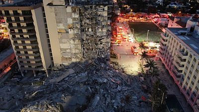 A view of the rubble after a 12-story, 136-unit condominium in Surfside, Fla., partially collapses, on June 24, 2021. Source: Miami-Dade Fire Rescue/Twitter.