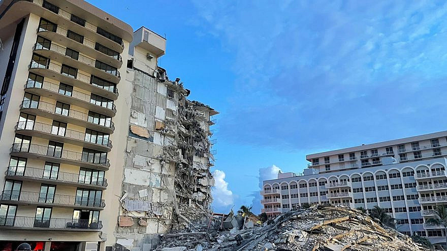 The collapsed portion of the Champlain Towers South condominium in Surfside, Fla., June 25, 2021 Source: Miami-Dade Fire Rescue/Twitter.