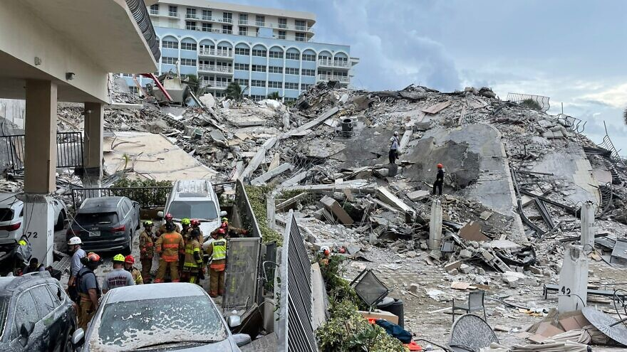 Search and rescue workers comb through the rubble of the Champlain Towers South condominium. Source: Miami-Dade Fire Rescue/Twitter.