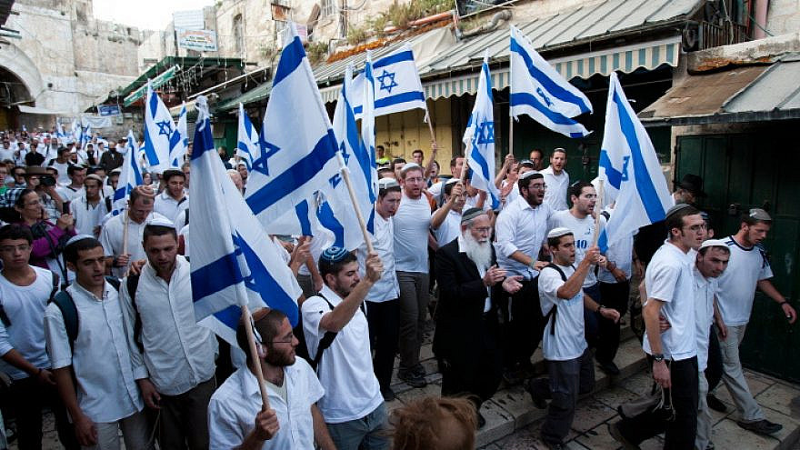 Thousands of Jews wave Israeli flags during a Jerusalem Day march, May 20, 2012. Photo by Yonatan Sindel/Flash90.